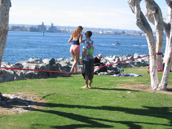 Two sweethearts enjoy slacklining at Embarcadero Marina Park South.