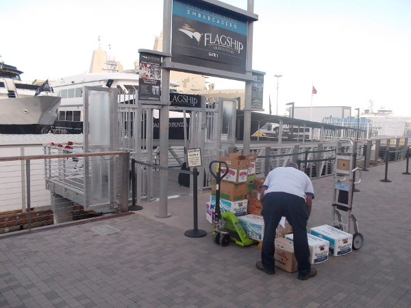 Unloading boxes of produce at the Flagship dock near Broadway Pier.