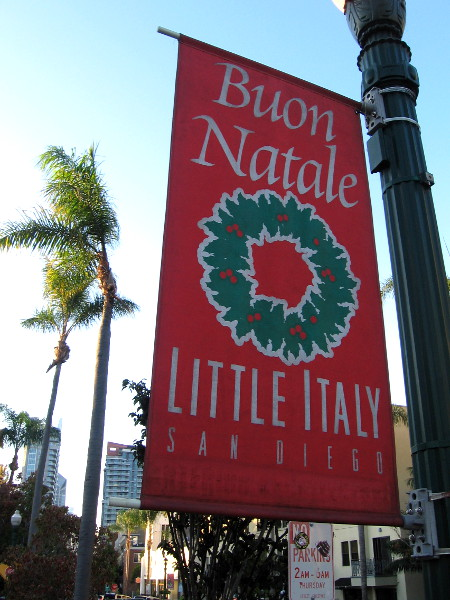 Possibly to flag down Santa while he flew by overhead, a Buon Natale banner was hung on a street lamp in San Diego's Little Italy neighborhood.