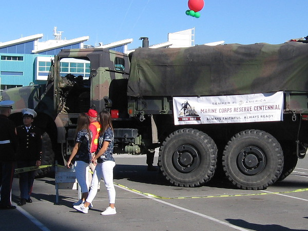Donated toys will fill this United States Marine Corps truck. A banner on its side commemorates the Marine Corps Reserve Centennial.