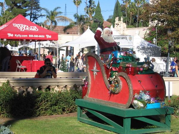 I've seen this Santa before. He hangs out in Balboa Park every holiday season. But his sled doesn't actually fly. It's all a complete fake. Impostor!