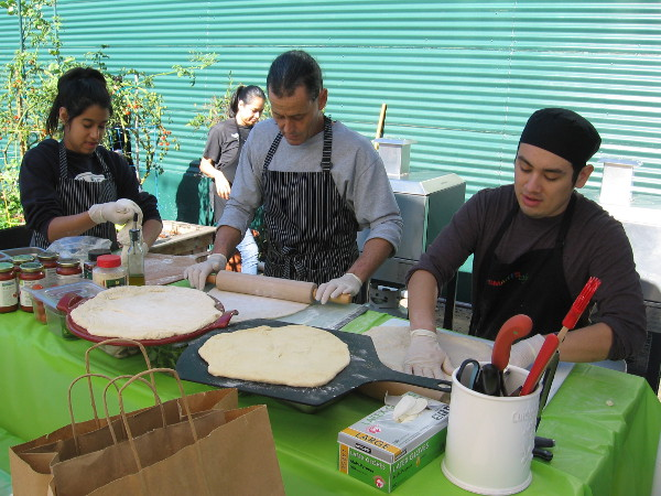 These guys were rolling out yummy pizzas!