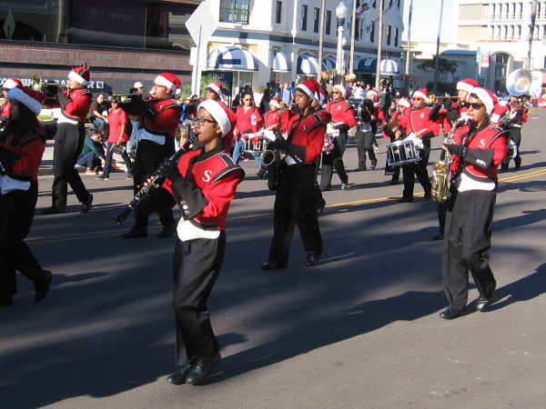 The Red Devils band marches by playing Christmas tunes!