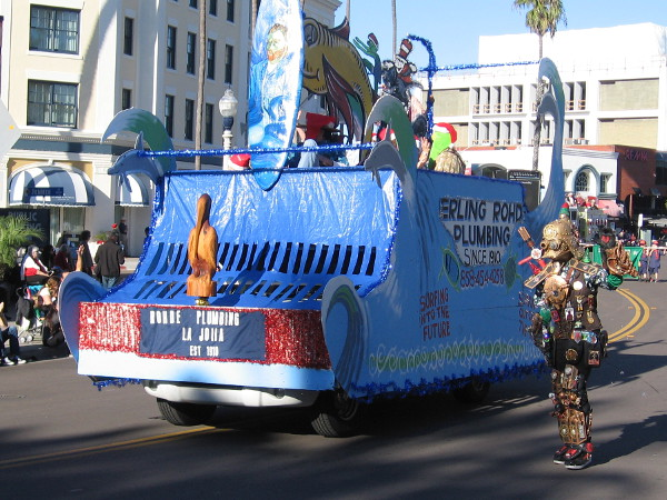 Just a fun float featuring a surfboard and Dr. Seuss characters. Like many, it was created by a local business. I've photographed the guy in the crazy Darth Vader outfit at other cool San Diego events!