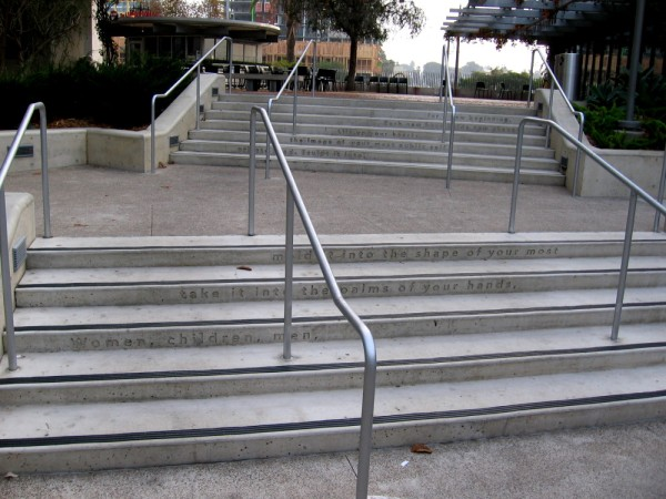 Words inscribed on steps leading to the San Diego Central Library. A portion of Maya Angelou's On the Pulse of Morning, a poem read during the 1993 Presidential Inauguration.