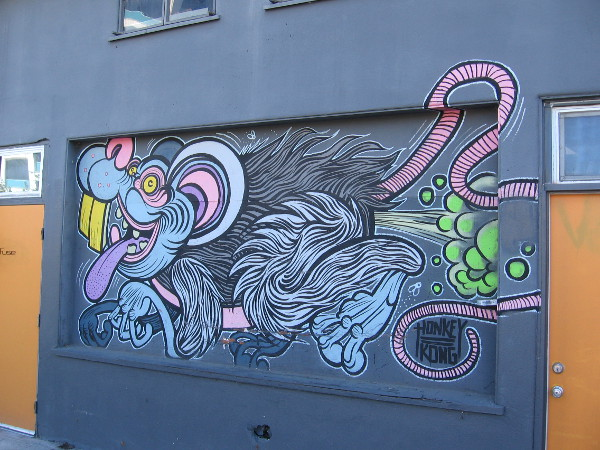 Look on the old Jerome's warehouse wall! It's a bizarre rat-like animal that farts green gas! Artist Adam Hathorn is Honkey Kong!