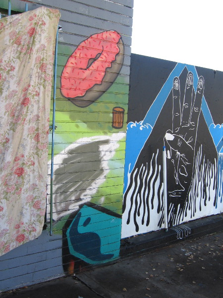 The wall along F Street at SILO has been painted with various cool bits of urban art. That doughnut is making me hungry.