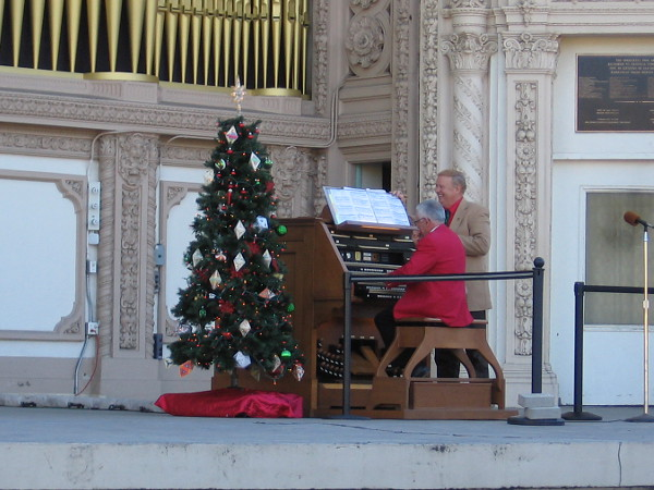 Spreckels Organ Curator Dale Sorenson smiles as he turns pages for San Diego Civic Organist Emeritus Robert Plimpton.