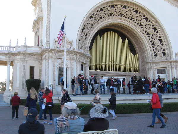 A crowd heads up onto the Spreckels Organ Pavilion stage. Anybody could join in the happy singing.