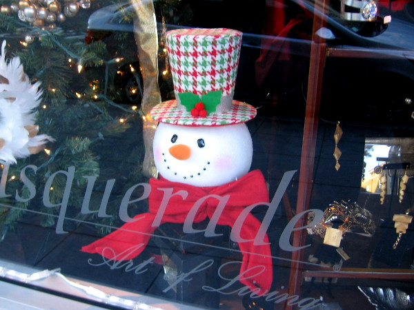 What is Frosty the Snowman up to in that window.