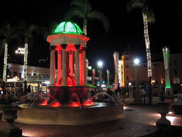 The recently restored 1910 Broadway Fountain is lit with red and green light during the Christmas season at Horton Plaza Park in downtown San Diego.