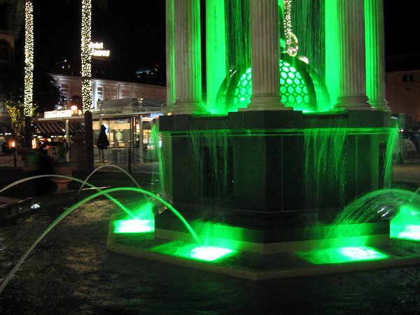 Light changes from red to green as water splashes in the beautiful 1910 Broadway Fountain designed by noted architect Irving J. Gill.