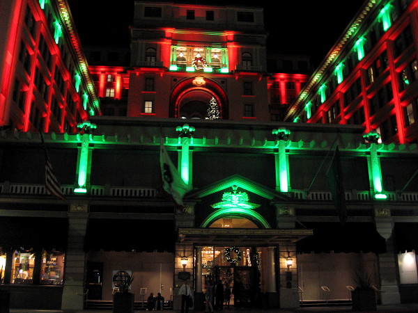 Across Broadway from Horton Plaza Park, the historic U.S. Grant hotel is also lit in Christmas colors for the holiday season.