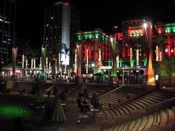 People have gathered for the evening in and around the Horton Plaza Park amphitheater. Downtown San Diego is lit beautifully for Christmas.