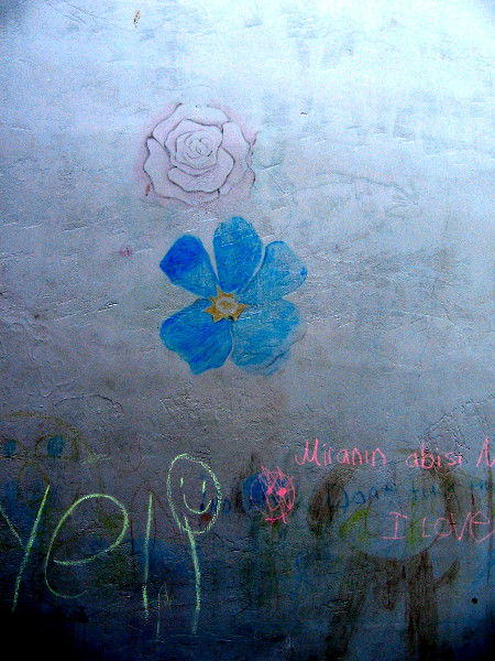 Chalk flowers on a playground's concrete wall, near The New Children's Museum in San Diego.