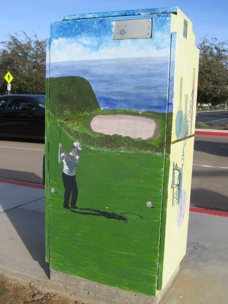 Another corner of the same intersection has a utility box with four cool images. This side shows a golfer taking a swing at the nearby Torrey Pines Golf Course.