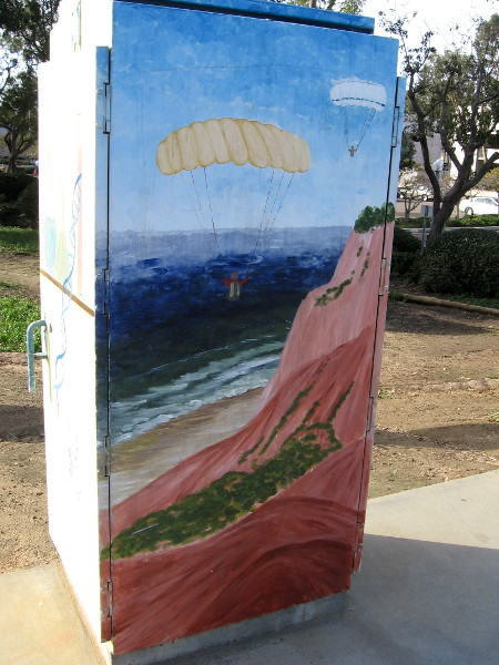 Also nearby is the Torrey Pines Gliderport. This fun street art depicts a couple of paragliders soaring above the Pacific Ocean!