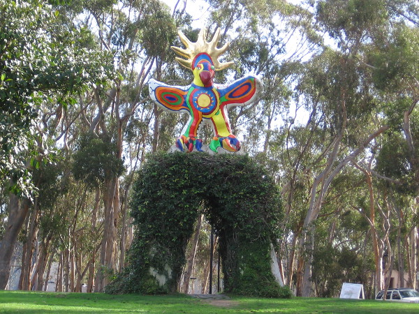 The impressive, brightly colorful Sun God stands with wings spread wide in sun-worshiping San Diego.