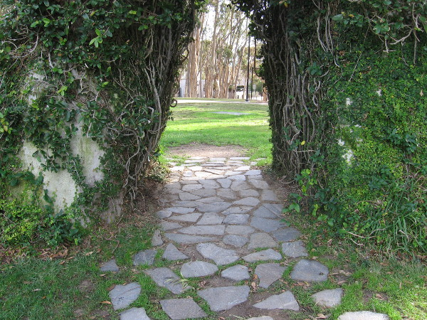A path of stones leads through the Sun God's green archway.