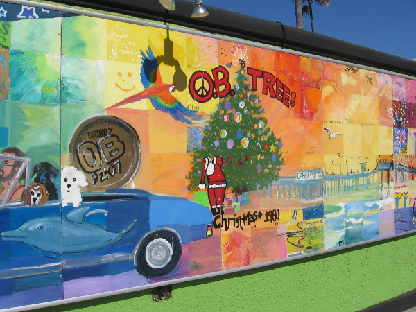 The OB Christmas tree near the beach is a focal point of this cool community mural!