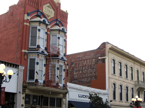 The building on the right is The McGurck Block, built in 1887. A drug store was located in it from 1903 to 1984. Actor Gregory Peck's father worked there as the night druggist.