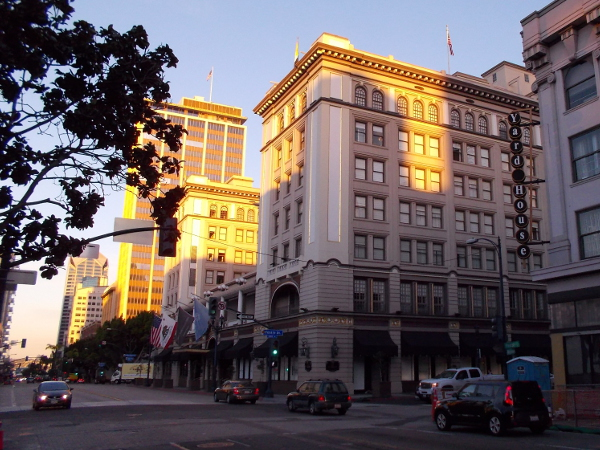 Photo of early sunlight slanting onto a few Broadway buildings in the heart of San Diego.