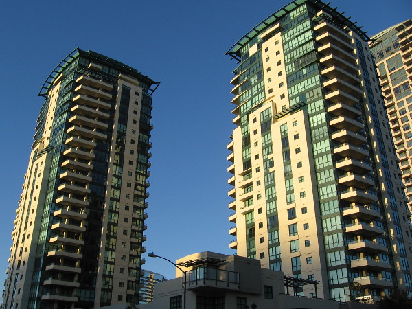 The beautiful Horizons Condos San Diego towers catch light from the rising sun.