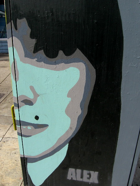 A blue face with a faint smile. Minimalist street art by Alex Avila.