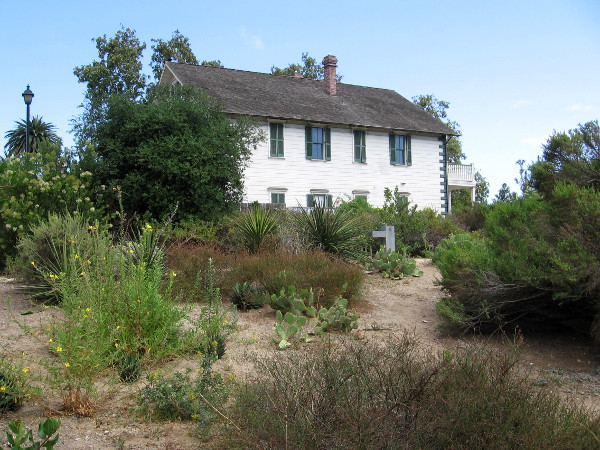 Photo of historic McCoy House in Old Town San Diego from the Native Garden. Today's garden is located in a spot once close to the San Diego River, before it was diverted to the north, through Mission Valley.