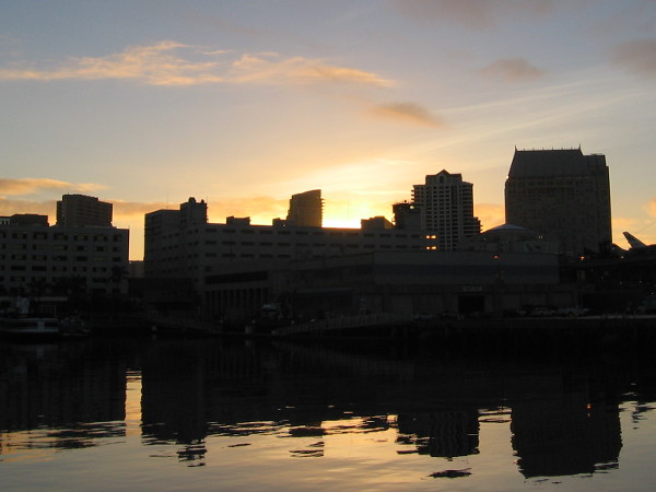 The sun is about to rise above a part of the San Diego skyline.