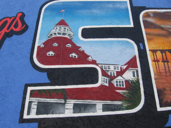 The distinctive Victorian roof of the Hotel del Coronado, a top San Diego resort and tourist attraction, appears in the letter S in a North Park mural.