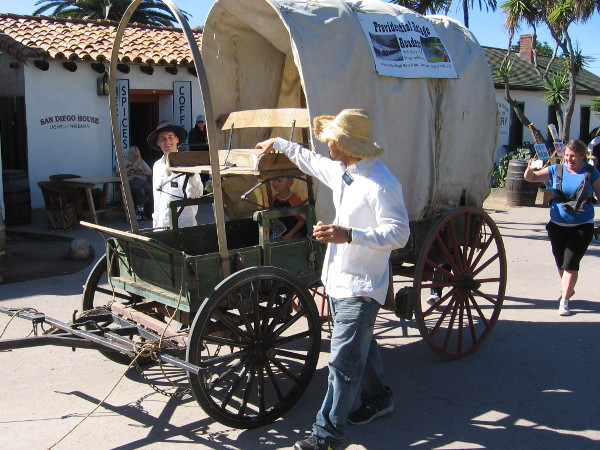Folks enjoy taking a ride in an old-fashioned covered wagon in Old Town San DIego during 2017 Mormon Battalion Commemoration Day.