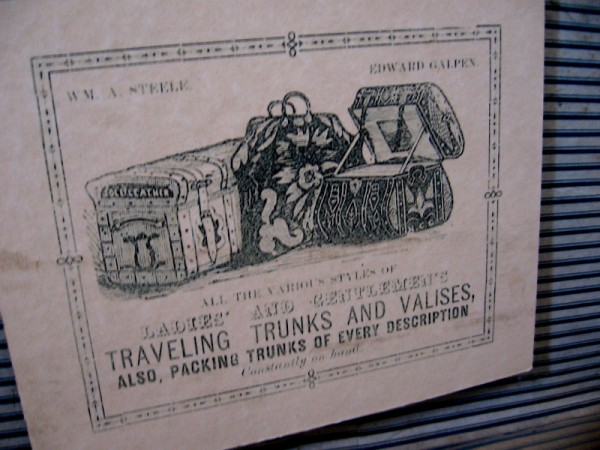 Advertisement shows Ladies' and Gentlemen's traveling trunks and valises, also packing trunks of every description.