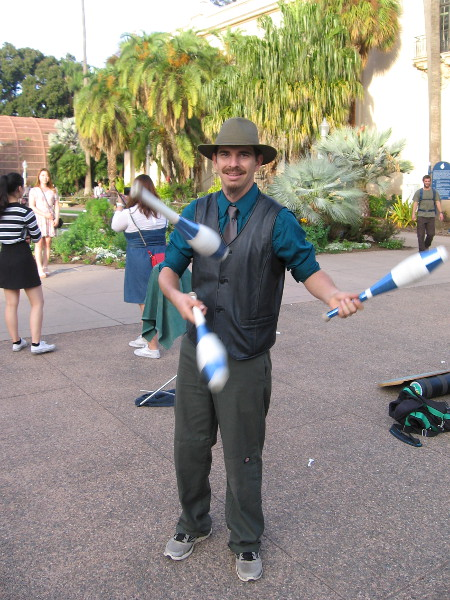 Kenny Shelton juggles in between magic acts. Today he tossed dizzy feelings of joy toward hundreds of people on El Prado.