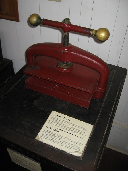 The copy machine of the 19th Century. Pressure from this heavy cast-iron letterpress transferred brown ink to tissue paper.