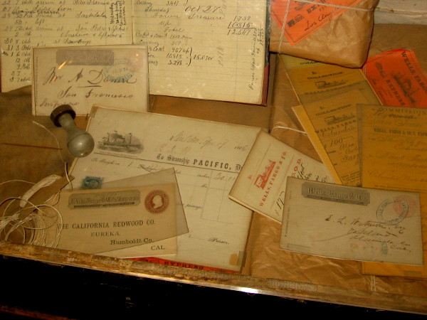 A collection of old letters, certificates and small packages exhibited at the Wells Fargo History Museum in San Diego.