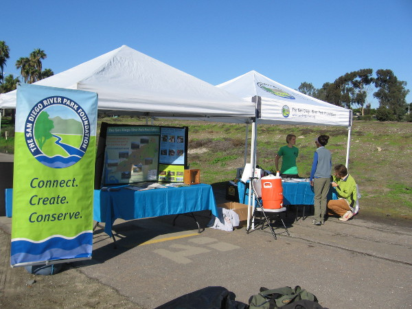 A tent where people can sign up to volunteer and learn more about The San Diego River Park Foundation.