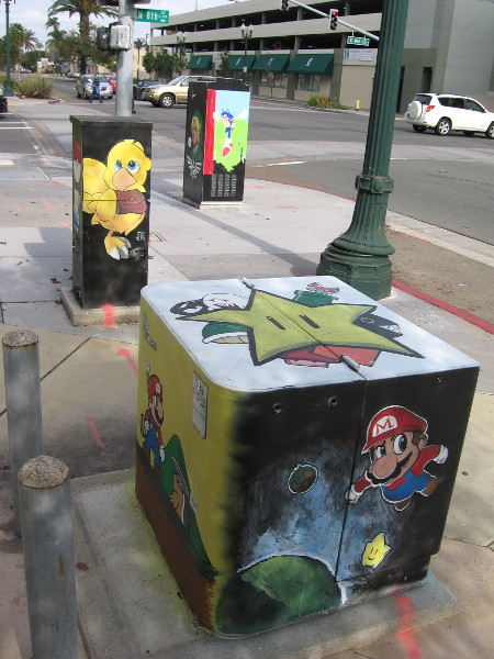 Painted utility boxes near the corner of National CIty Boulevard and East 8th Street feature a variety of colorful Japanese video game characters.