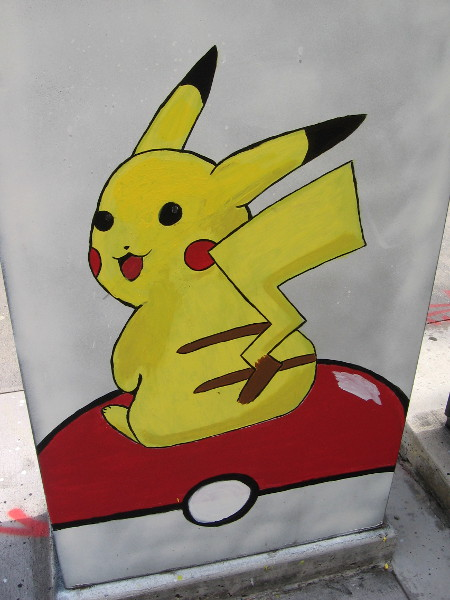 Pikachu sits atop a Pokémon Poké Ball. Fun street art in National City.