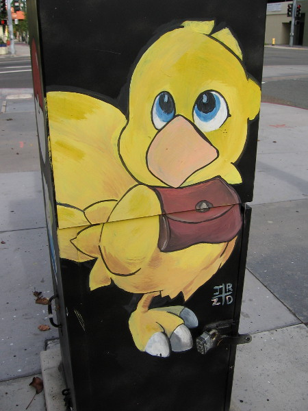 Chocobo from the Final Fantasy video games. Happy street art painted on a utility box.
