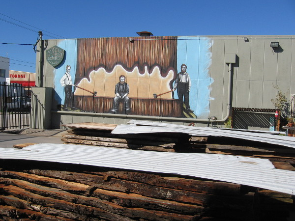 Another photo of the lumberjack mural, just beyond some real lumber!