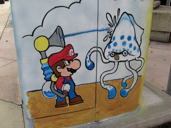 Nintendo's pop culture icon Mario fights Gooper Blooper in this fun, nostalgic street art.