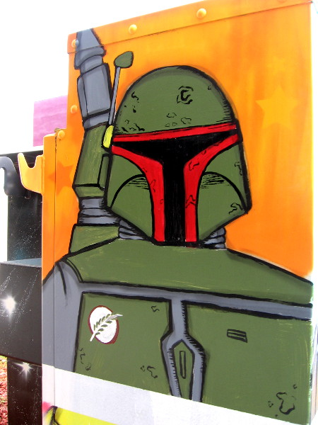 Bounty hunter Boba Fett, a popular Star Wars character, makes for some very cool street art! I photographed this on the left side of the utility box.