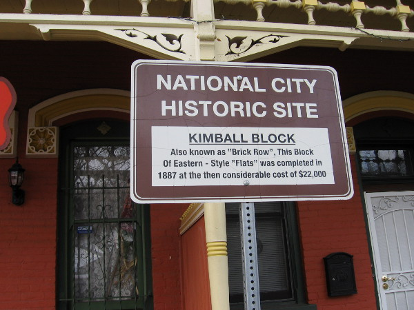 Sign reads National City Historic Site - Kimball Block - Also known as Brick Row, this block of Eastern-style flats was completed in 1887 at the then considerable cost of 22,000.
