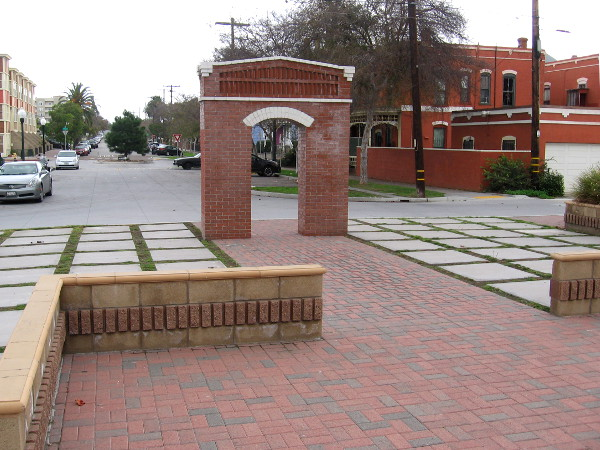 Visible beyond the brick arch is one end of Brick Row, one of several historic buildings in Heritage Square.