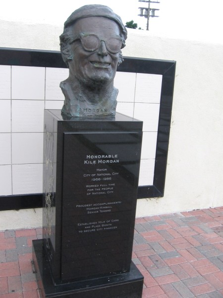 The bust of Honorable Kile Morgan, mayor of National City 1966-1986. He established the Mile of Cars and Plaza Bonita. Sculpture created by San Diego artist Richard Becker.