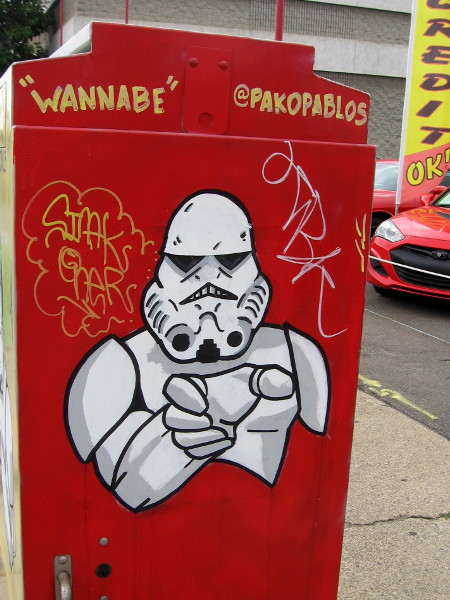 Wannabe Stormtrooper on a second utility box seems to idolize Darth Vader and his mastery of the Dark Force.