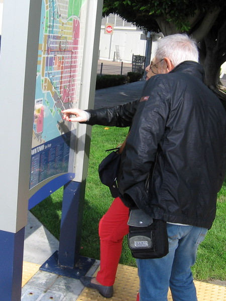 Visitors to San Diego check out a map of the Embarcadero.