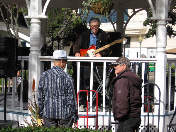 Member of the Cat-illacs band chats with folks at Seaport Village's East Plaza Gazebo.