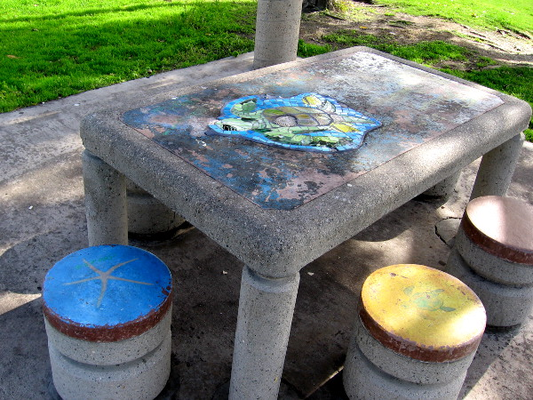 Colorful but weathered picnic table at Embarcadero Marina Park North is the remnant of public art from years ago.